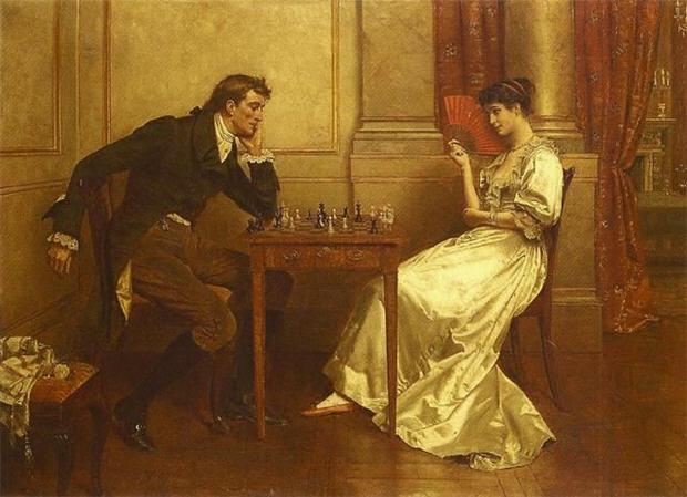 женщина и мужчина играют в шахматы